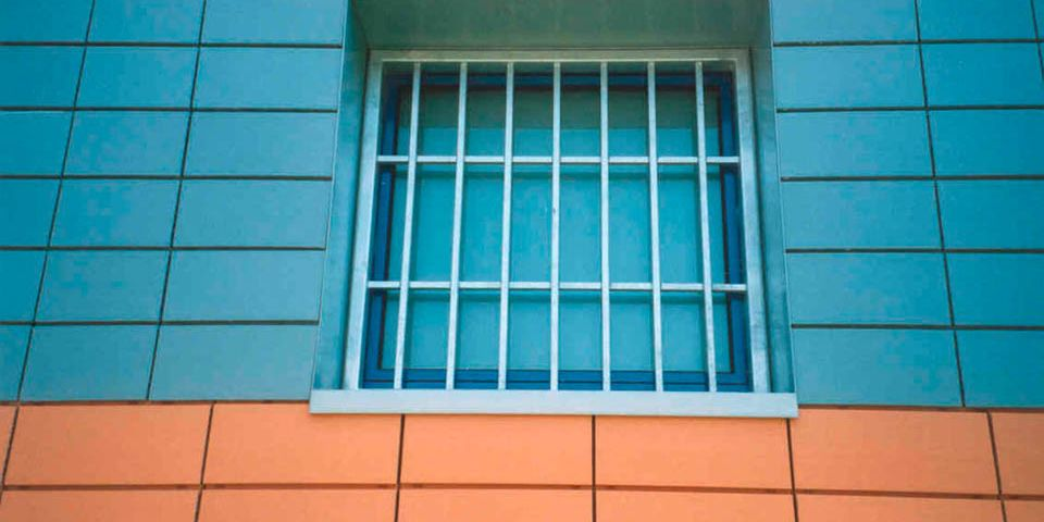 Cell window with grille.